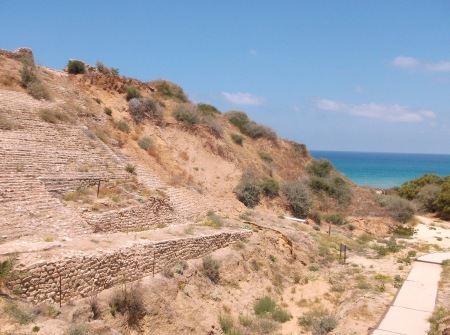 The Canaanite-era ramparts at Ashkelon, and one of the oldest archways known to history (partially reconstructed in the photo below).  Above the ramparts, you can see the Philistine tower and the Hellenistic walls.